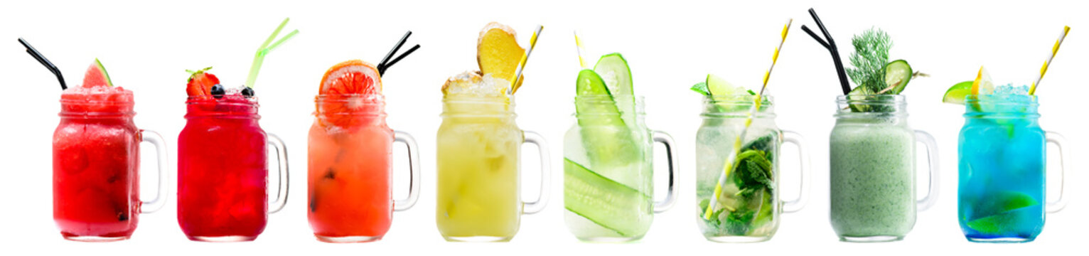 Set of classical fresh delicious smoothies and lemonades in a vintage mason jars with straws on light background. Fresh natural healthy fruit and berry drinks