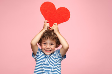 Charming kid posing with heart