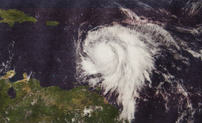 Geocolor Image in the eye of Hurricane Maria strengthened to a Category 3 just east of the Leeward Islands. Elements of this image furnished by NASA.