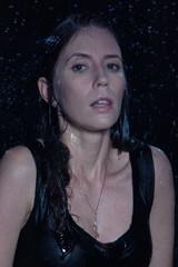 Sexy beautiful woman under rain