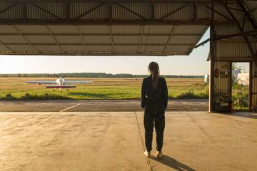 Woman posing inside of hangar