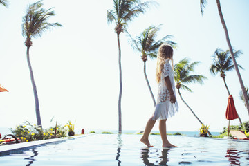 Woman Enjoying Summertime at Exotic Resort