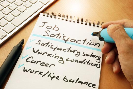Job satisfaction list written by hand.