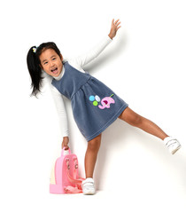 Happy young little child girl with backpack for first class expressing