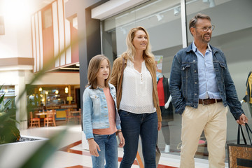 Family on shopping day walking in mall