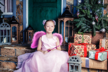 Girl in fairy costume sitting on the stairs