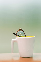 eyeglass in cup on the table