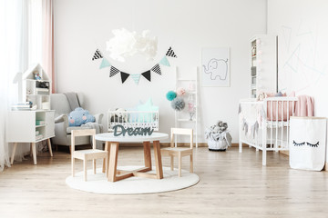 Child's room with white furniture