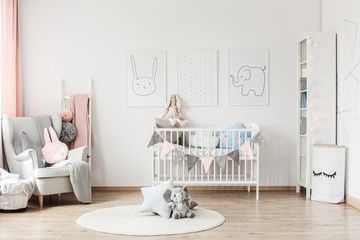 Baby's room with grey armchair