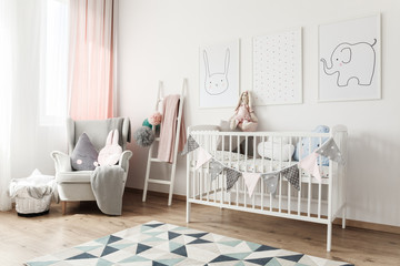 White baby's room with pictures