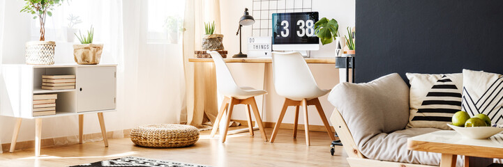 Workspace with two white chairs