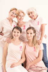 Women in pink shirts and pink ribbons