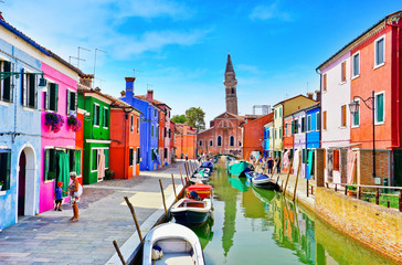 View of the colorful Venetian houses along the canal at the Islands of Burano in Venice.