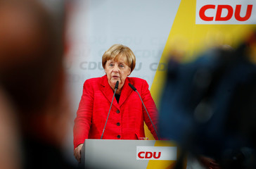 German Chancellor Angela Merkel, a top candidate of the Christian Democratic Union Party for the upcoming general elections, speaks during an election rally in Wismar