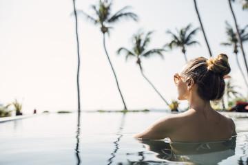 Woman Enjoying Summertime in Swimming Pool