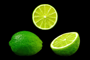 Set of fresh limes isolated on the black background