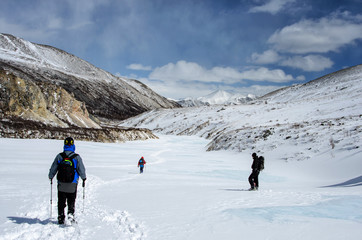 hiking in winter mountains. People traveling
