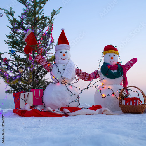 snowman new year background christmas and festive decorations couple of snowmen in snow
