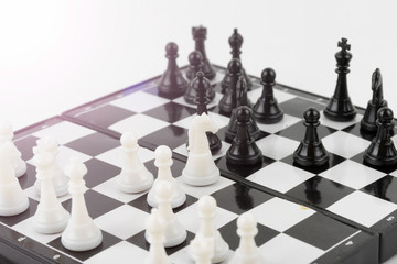 Chess photographed on a chess board isolated white background