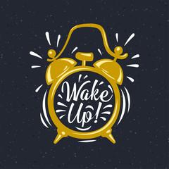 Wake up! inscription on gold Alarm Clock.