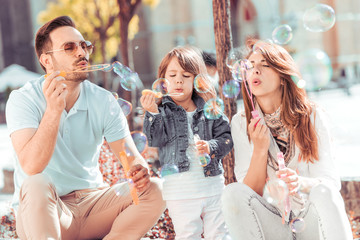 Happy family relaxing in the city.