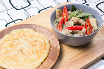 Beef green curry served with roti