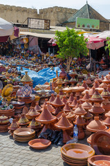 Hundreds of colorful tajine cooking pots stacked on market in soukh of Meknes, Morocco, North Africa