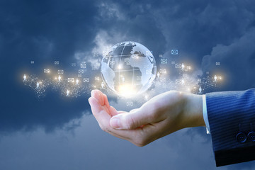 Global business network in businessman hand .
