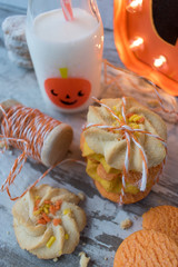 festive halloween sugar cookies with decorations and milk