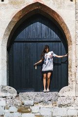 Woman posing at big door