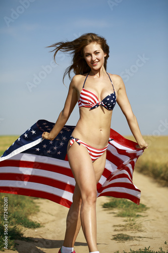 3beb40bf94db4 Sexy woman in sexy American flag bikini in a wheat field