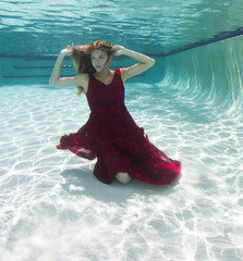 Beautiful young women in a swimsuit, or mermaids tail above and below the water.