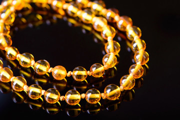 amber beads accessory on black background