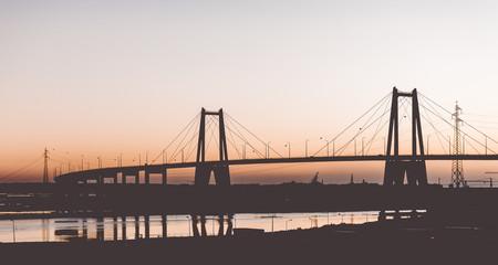 Canvas Prints Bridge Silhouette of the suspension concrete bridge on a sunset