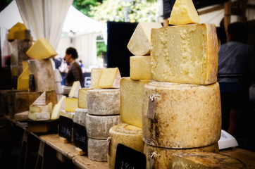 traditional hard cheese on a market stall in Italy