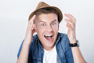 handsome man in denim with hat