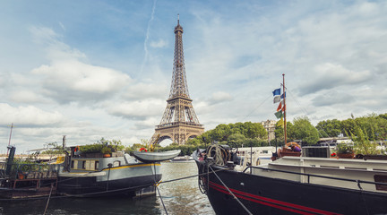 Seine in Paris with Eiffel tower at a cloudy summer day