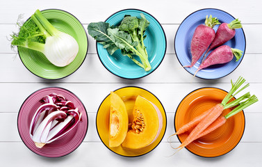 Fotobehang Groenten Colorful vegetables collection: fennel, broccoli, radishes, late red radicchio from Treviso, pumpkin and carrots