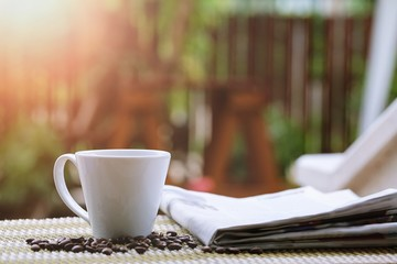 Morning coffee closeup outdoor garden blur background