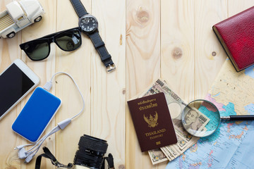 Top View Of Traveler's Accessories Along For The Trip On Wooden Table, Essential Vacation Items, Travel And Vacations Concept For Background