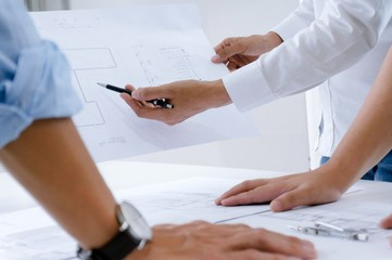 Colleagues interior designer Corporate Achievement Planning Design on blueprint Teamwork Concept with compasses.