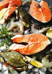 Fresh seafood: salmon steak, shrimps and crabs