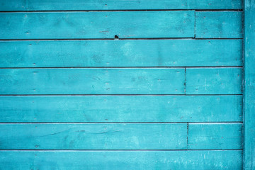 Old wood texture, blue background.