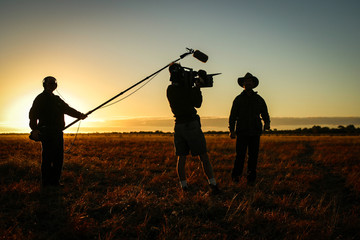 media team, filming and sound boom at sunset outback Australia