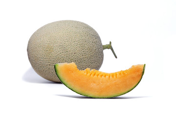 Melon fruit and sliced orange melon to show the juicy flesh on white background.