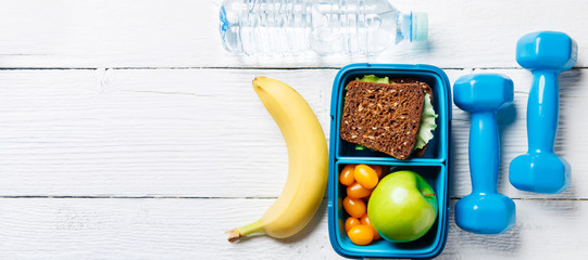Picture of apple, sandwich, tomato in box, dumbbell