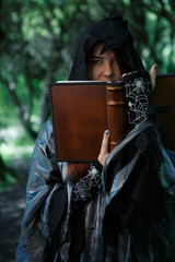 Black witch with magic book