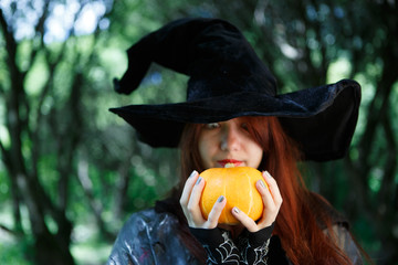 Close-up image of witch with pumpkin