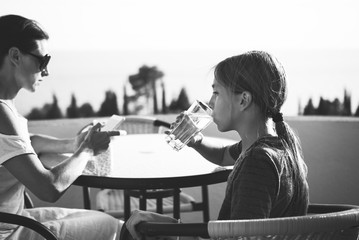 Girl sitting on balcony and drinking water