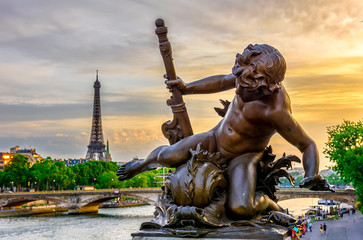 Wall Mural - Sculpture on the bridge of Alexander III with the Eiffel Tower in the background at sunset in Paris, France.